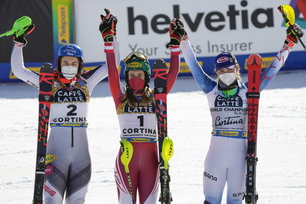 Austria's Katharina Liensberger, center, winner of the women's slalom, poses with second placed Slovakia's Petra Vlhova, left, and third placed United...