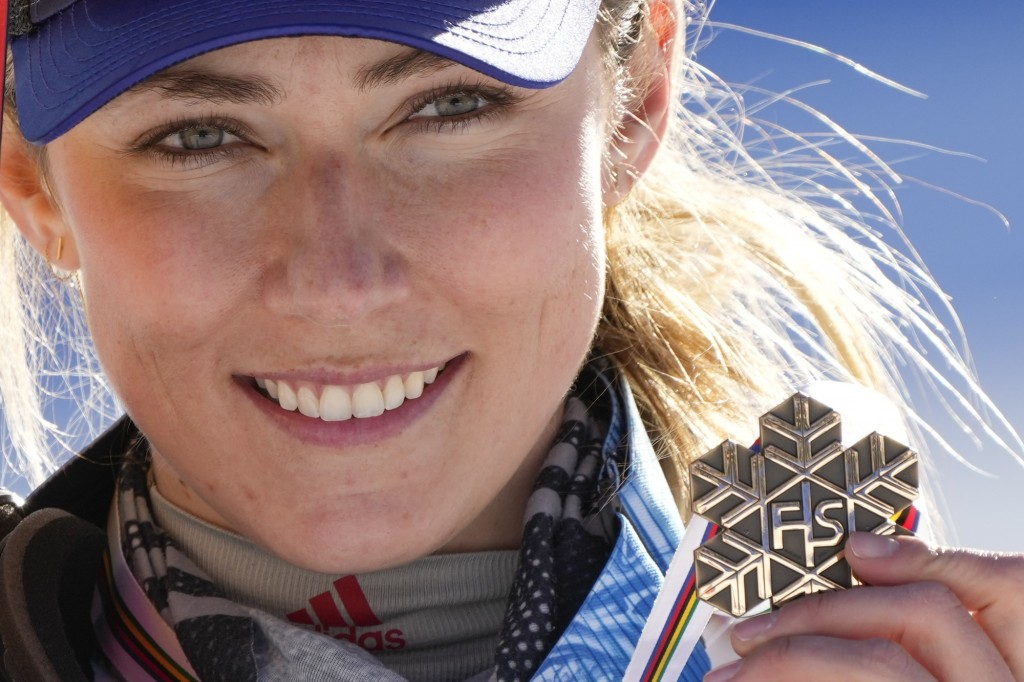 United States' Mikaela Shiffrin shows her bronze medal of the women's slalom, at the alpine ski World Championships in Cortina d'Ampezzo, Italy, Satur...