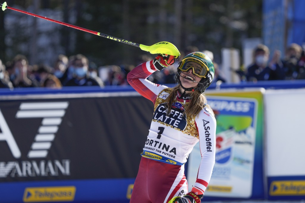 Austria's Katharina Liensberger celebrates after winning the women's slalom, at the alpine ski World Championships in Cortina d'Ampezzo, Italy, Saturd...
