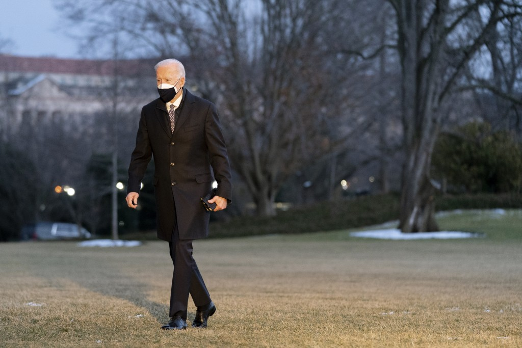 President Joe Biden walks on the South Lawn of the White House after stepping off Marine One, Friday, Feb. 19, 2021, in Washington. Biden is returning...