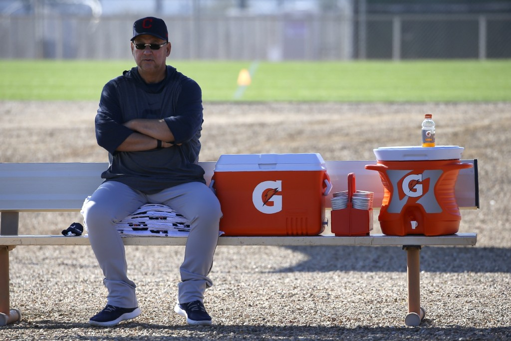 FILE - Cleveland Indians manager Terry Francona looks on during spring training baseball workouts for pitchers and catchers in Avondale, Ariz., in thi...