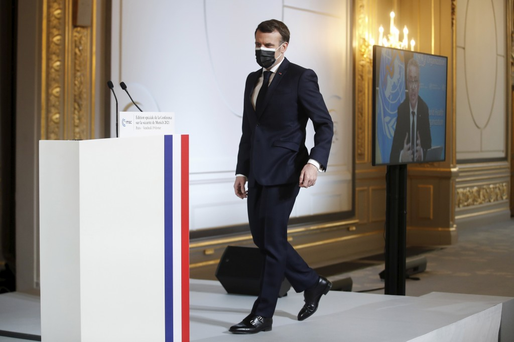 French President Emmanuel Macron arrives a video-conference meeting ahead of 2021 Munich Security Conference at the Elysee palace in Paris, Friday Feb...