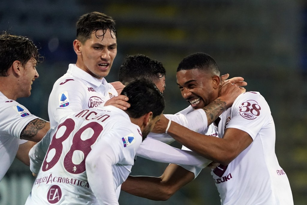 Torino's Gleison Bremer, right, celebrates with teammates after scoring a goal during a Serie A soccer match between Cagliari and Torino, in Cagliari'...