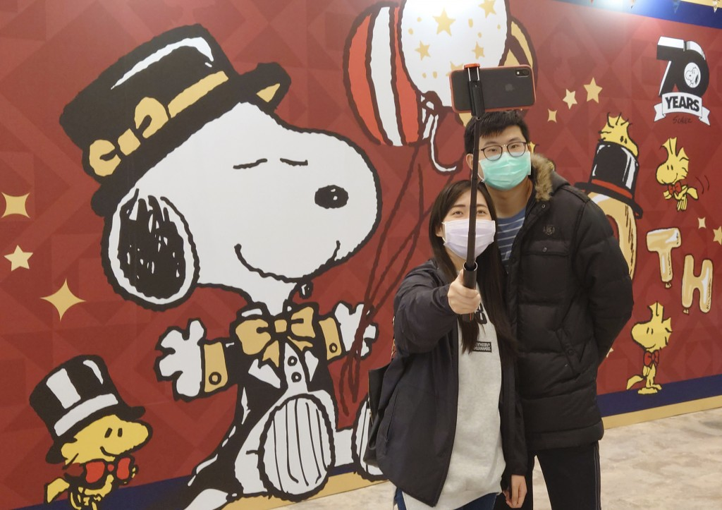 People wearing face masks to help curb the spread of the coronavirus visit the popular cartoon dog Snoopy's 70th Anniversary Exhibition in Taipei, Tai...