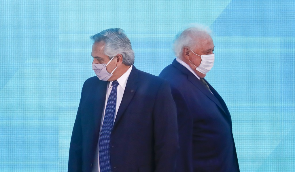 FILE - In this Jan. 14, 2021 file photo, Argentine President Alberto Fernandez, left, walks past Health Minister Gines Gonzalez Garcia as they arrive ...