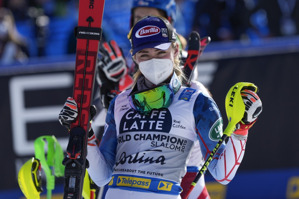 United States' Mikaela Shiffrin celebrates her third place in the women's slalom, at the alpine ski World Championships in Cortina d'Ampezzo, Italy, S...