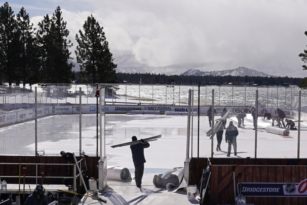 Workers put the finishing touches on the temporary ice rink, Friday, Feb. 19, 2021, built at the Edgewood Tahoe Resort, that will host two NHL games, ...