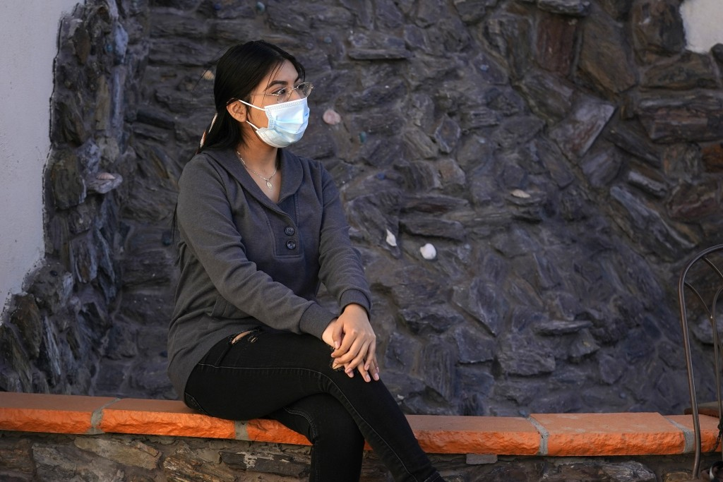 Stephanie Cruz Vazquez poses for photographs Wednesday, Feb. 17, 2021, in Phoenix. She said her severe anxiety was amplified so much by her virus conc...