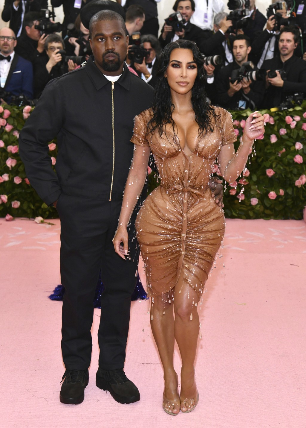 """FILE - Kanye West, left, and Kim Kardashian attend The Metropolitan Museum of Art's Costume Institute benefit gala celebrating the opening of the """"Cam..."""