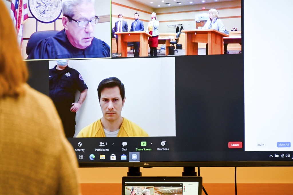 Judge Joseph G. McGraw, on the screen in the upper left square, listens as Duke Webb, bottom square,  is arraigned at Winnebago County Justice Center ...