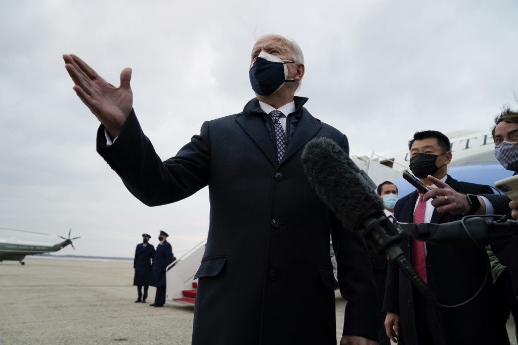 President Joe Biden speaks to member of the media after exiting Air Force One, Friday, Feb. 19, 2021, in Andrews Air Force Base, Md. (AP Photo/Evan Vu...