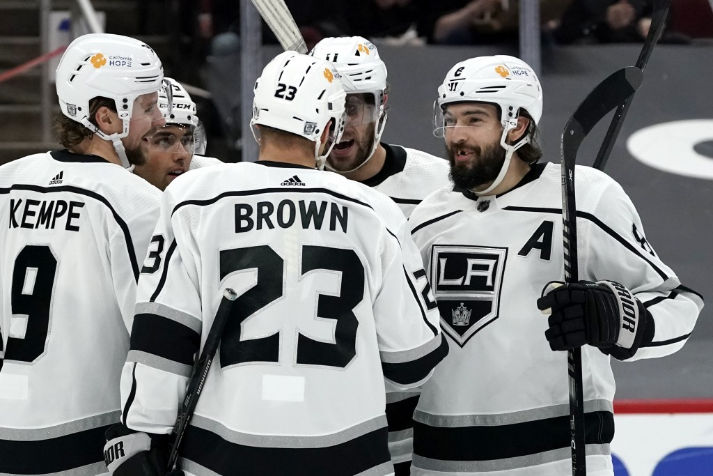 Los Angeles Kings defenseman Drew Doughty (8), center Anze Kopitar (11), right wing Dustin Brown (23), and right wing Adrian Kempe (9) celebrates a go...