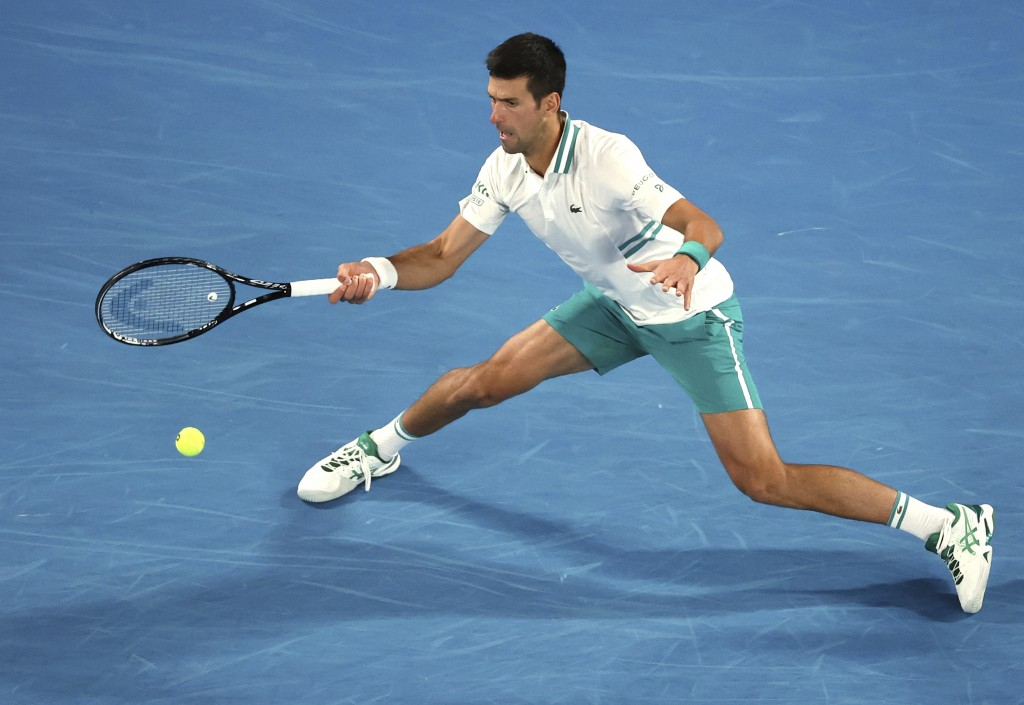 Serbia's Novak Djokovic hits a forehand to Russia's Daniil Medvedev during the men's singles final at the Australian Open tennis championship in Melbo...