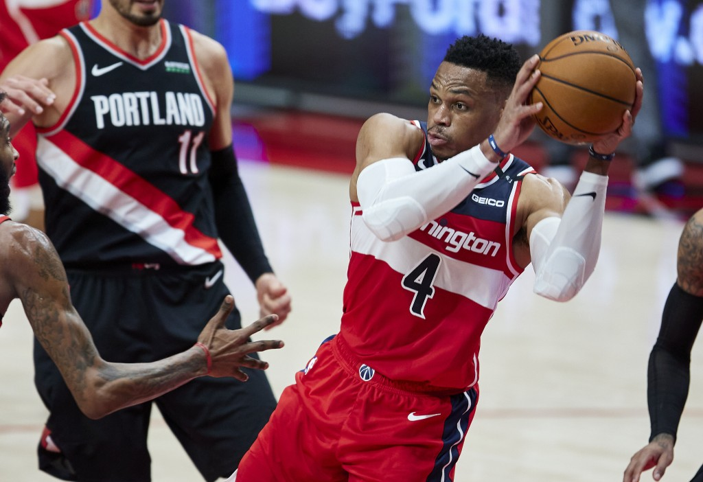 Washington Wizards guard Russell Westbrook looks to pass the ball during the first half of the team's NBA basketball game against the Portland Trail B...