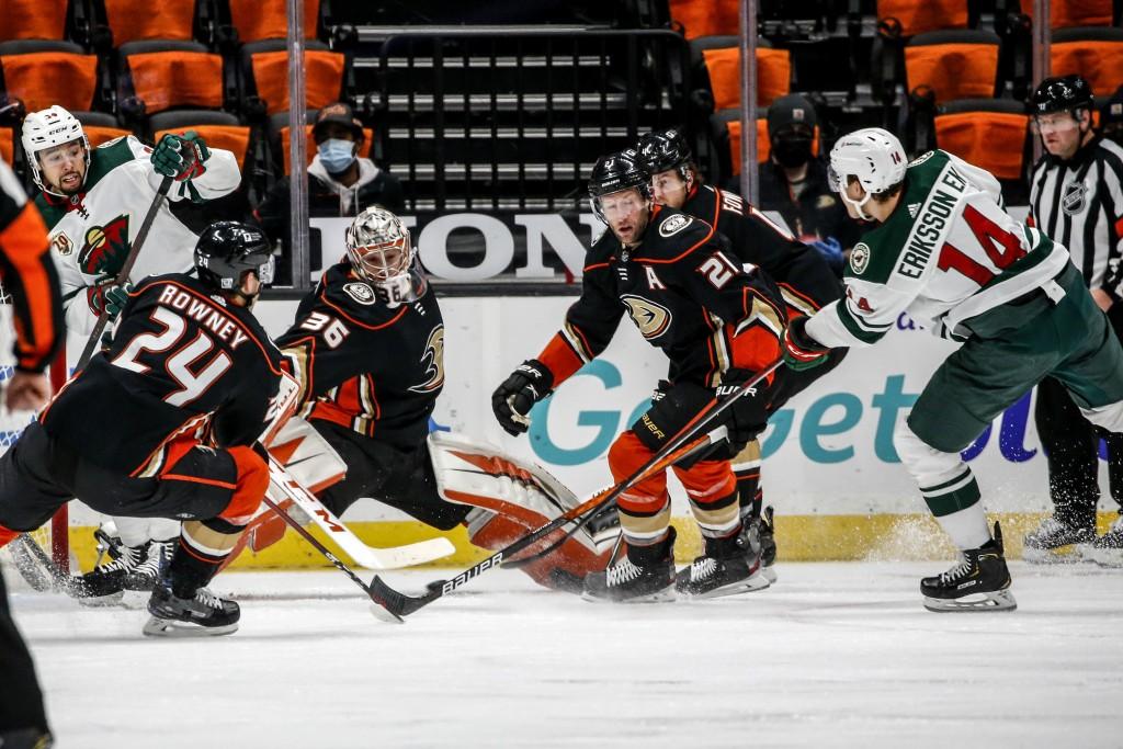 Minnesota Wild forward Joel Eriksson Ek (14) shoots as Anaheim Ducks goalie John Gibson (36) defends during the second period of an NHL hockey game Sa...