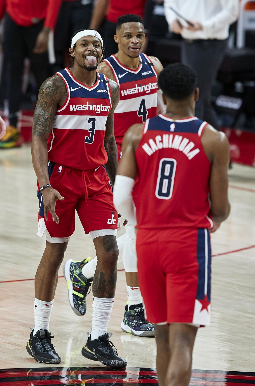 Washington Wizards guard Bradley Beal, left, reacts at the end of the team's NBA basketball game against the Portland Trail Blazers in Portland, Ore.,...