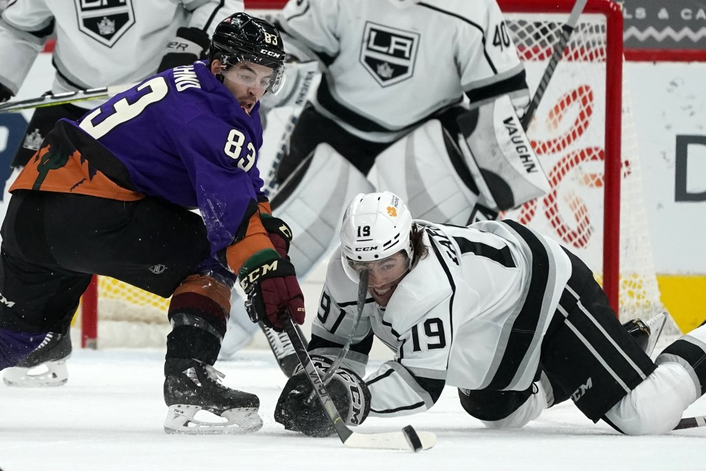 Arizona Coyotes right wing Conor Garland (83) battles with Los Angeles Kings right wing Alex Iafallo (19) for the puck during the second period of an ...