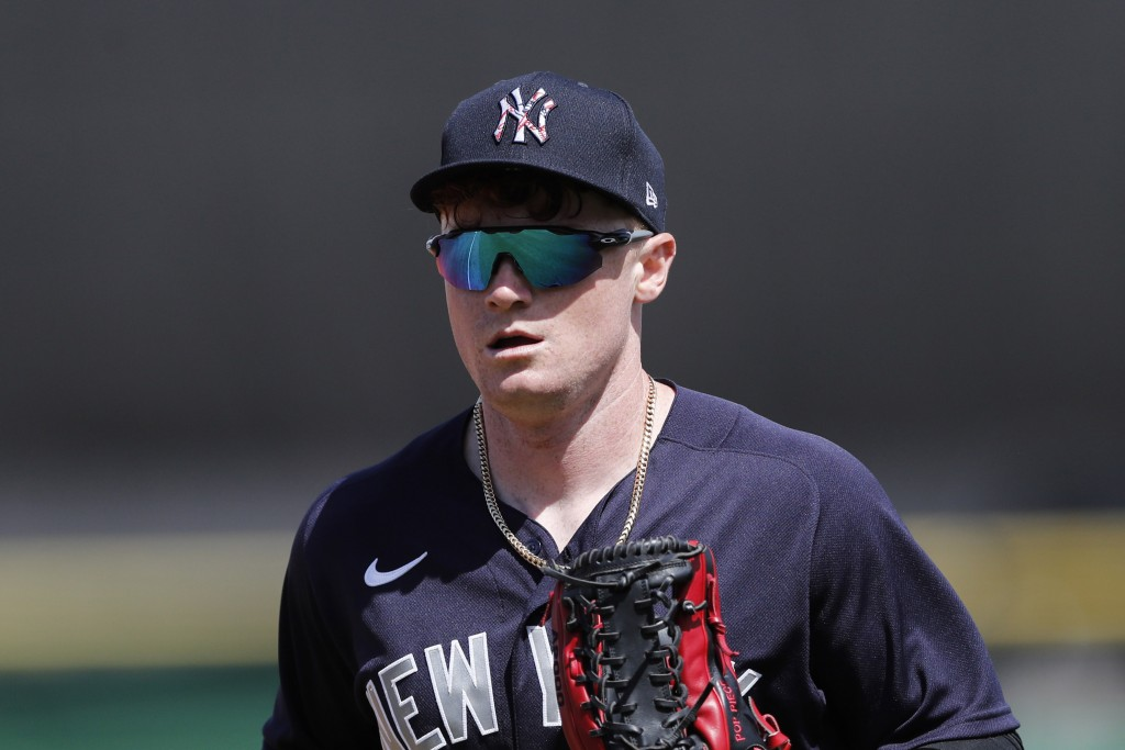 FILE - In this March 9, 2020, file photo, New York Yankees' Clint Frazier runs to the dugout during a spring training baseball game in Clearwater, Fla...