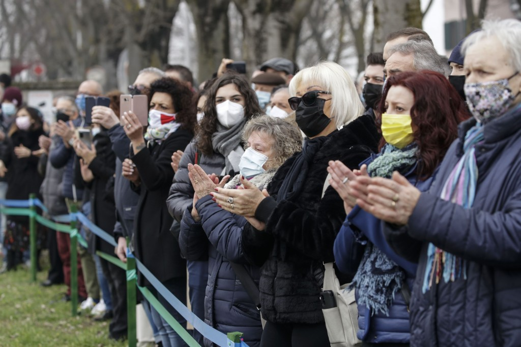 Codogno's citizens attend the unveiling of a memorial for Covid deaths, in Codogno, northern Italy, Sunday, Feb. 21, 2021. The first case of locally s...