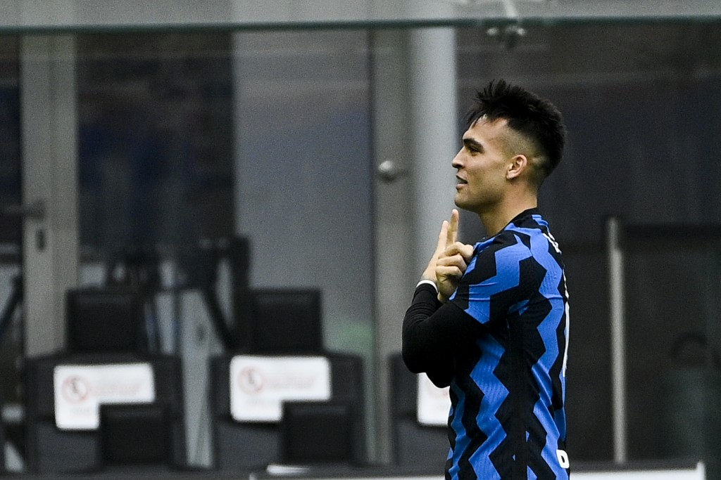 Inter's Lautaro Martinez celebrates after scoring his side's opening goal during the Serie A soccer match between AC Milan and Inter Milan, at the San...