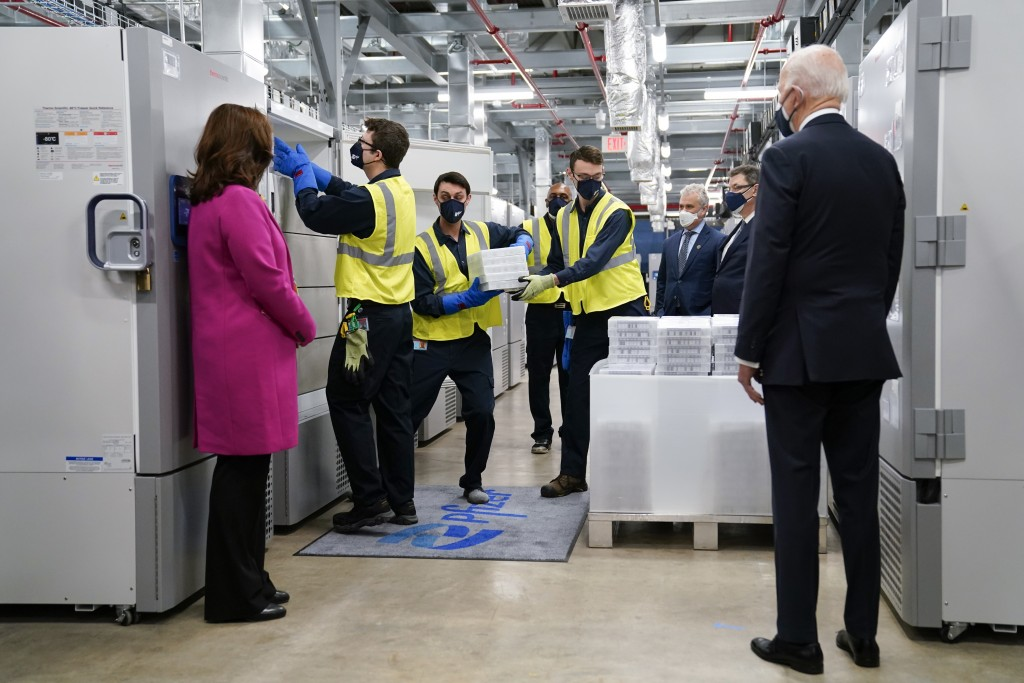 FILE - In this Feb. 19, 2021, file photo President Joe Biden, right, and Michigan Gov. Gretchen Whitmer, left, tour a Pfizer manufacturing site in Por...