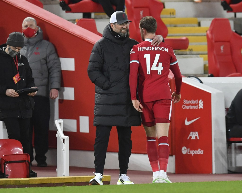 Liverpool's Jordan Henderson is hugged by Liverpool's manager Jurgen Klopp as he is substituted after an injury during the English Premier League socc...