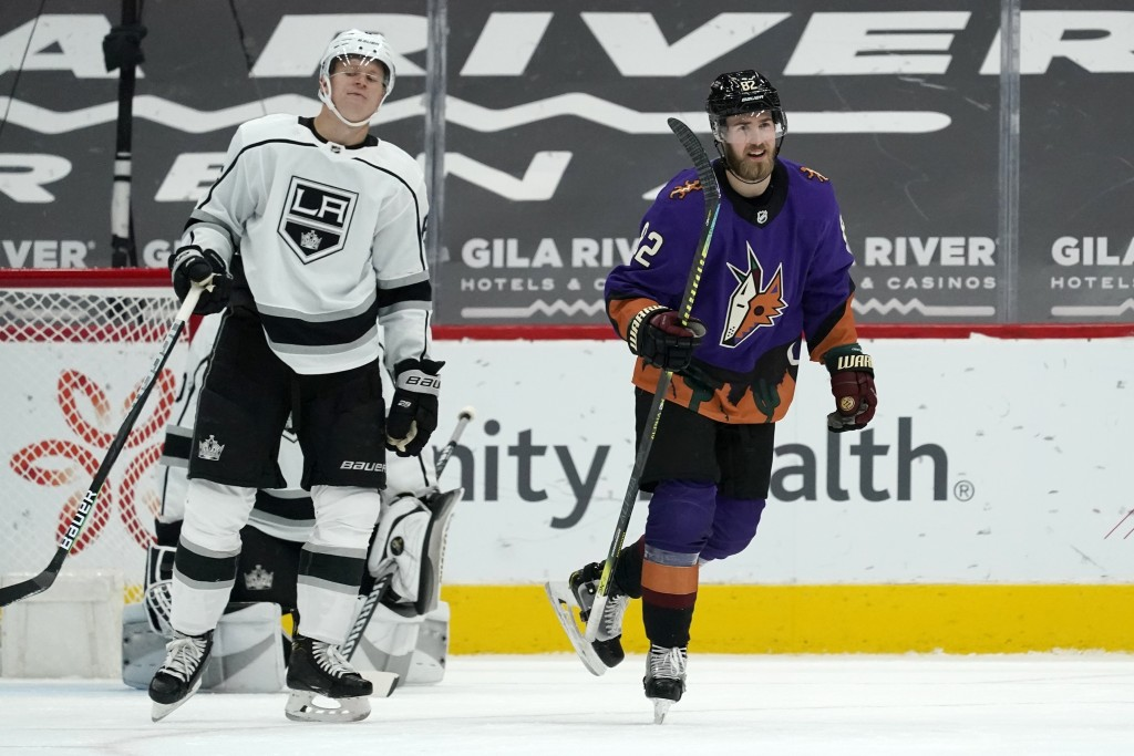 Arizona Coyotes defenseman Jordan Oesterle (82) smiles as the goes to celebrate a goal by teammate Coyotes' Derick Brassard as Los Angeles Kings defen...