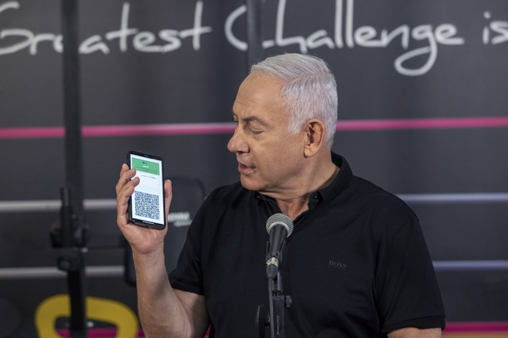 Israeli Prime Minister Benjamin Netanyahu talks to the media during a visit to the Fitness gym ahead of the re-opening of the branch in Petah Tikva, I...