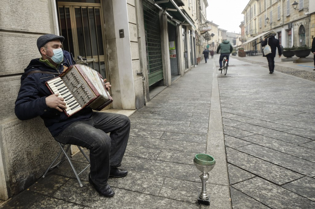 A man plays an accordion in Codogno, northern Italy, Sunday, Feb. 21, 2021. The first case of locally spread COVID-19 in Europe was found in the small...