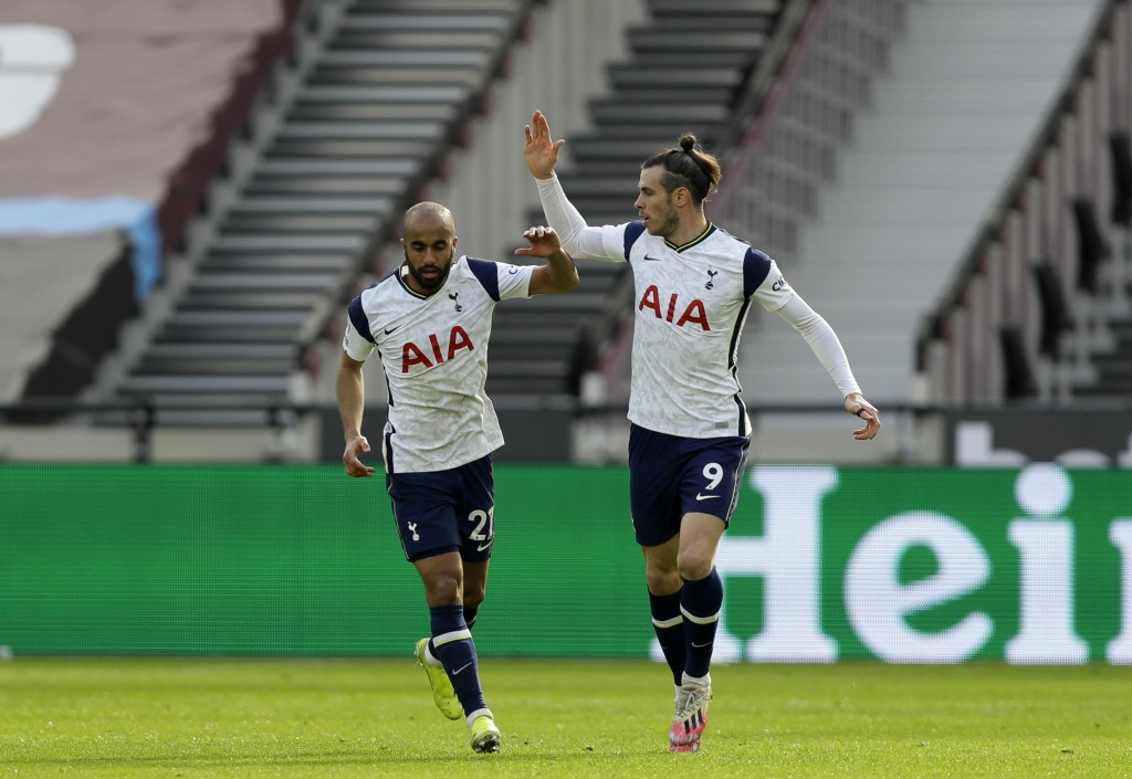 Tottenham's Lucas Moura, left, celebrates with Tottenham's Gareth Bale after scoring his side's opening goal during the English Premier League soccer ...