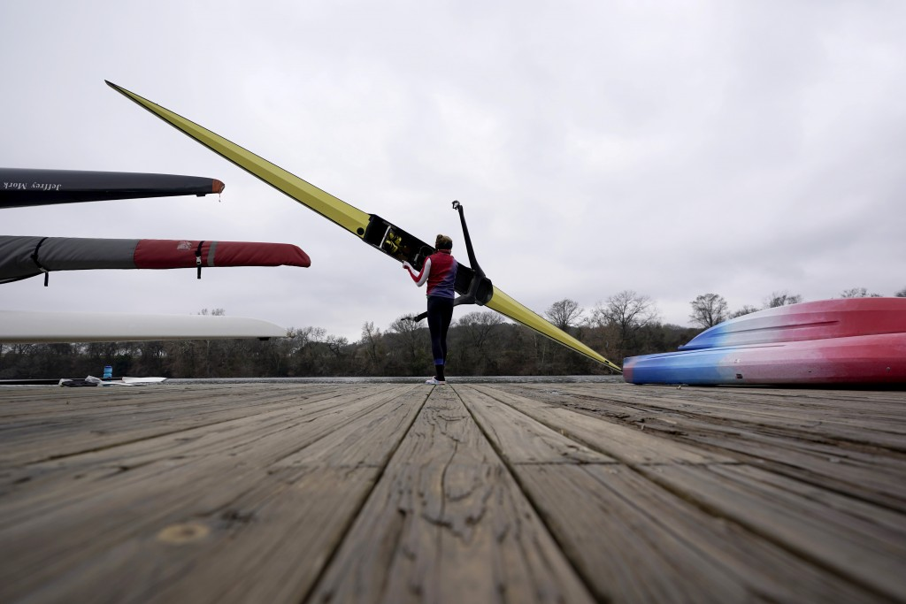 Rower Gevvie Stone prepares to launch her boat at Lady Bird Lake ahead of the upcoming U.S. Olympic rowing trials, Friday, Feb. 12, 2021, in Austin, T...
