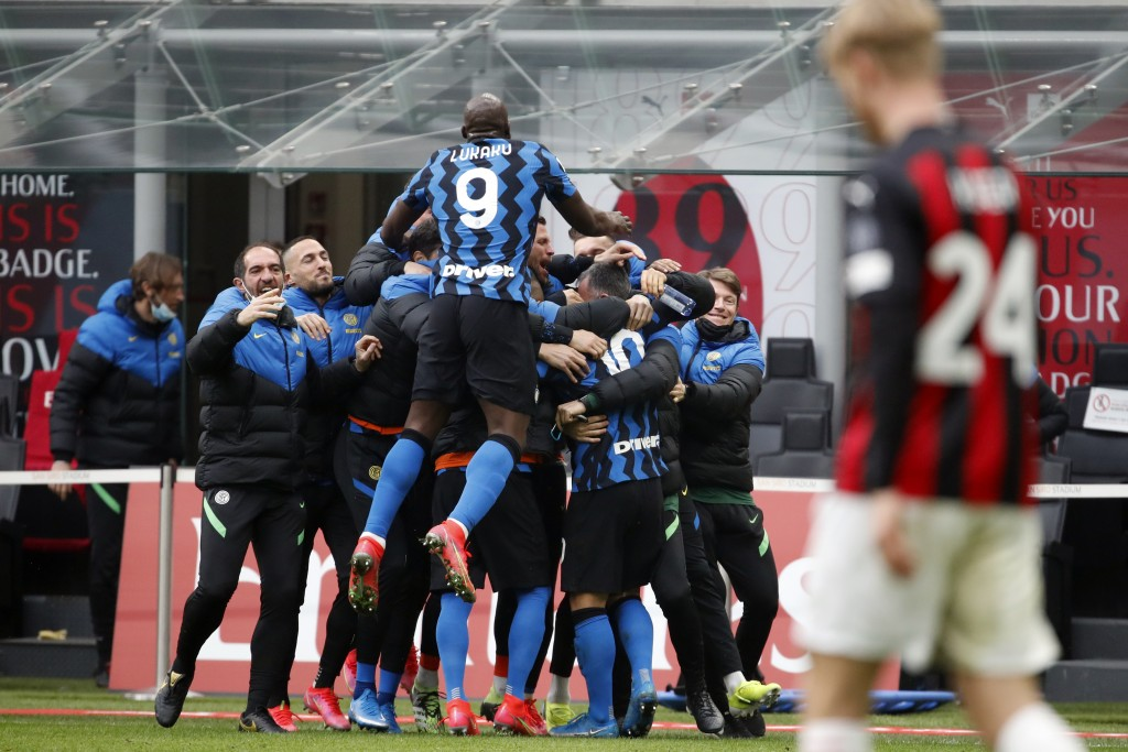 Inter players celebrate after Lautaro Martinez scored his side's second goal, during the Serie A soccer match between AC Milan and Inter Milan, at the...