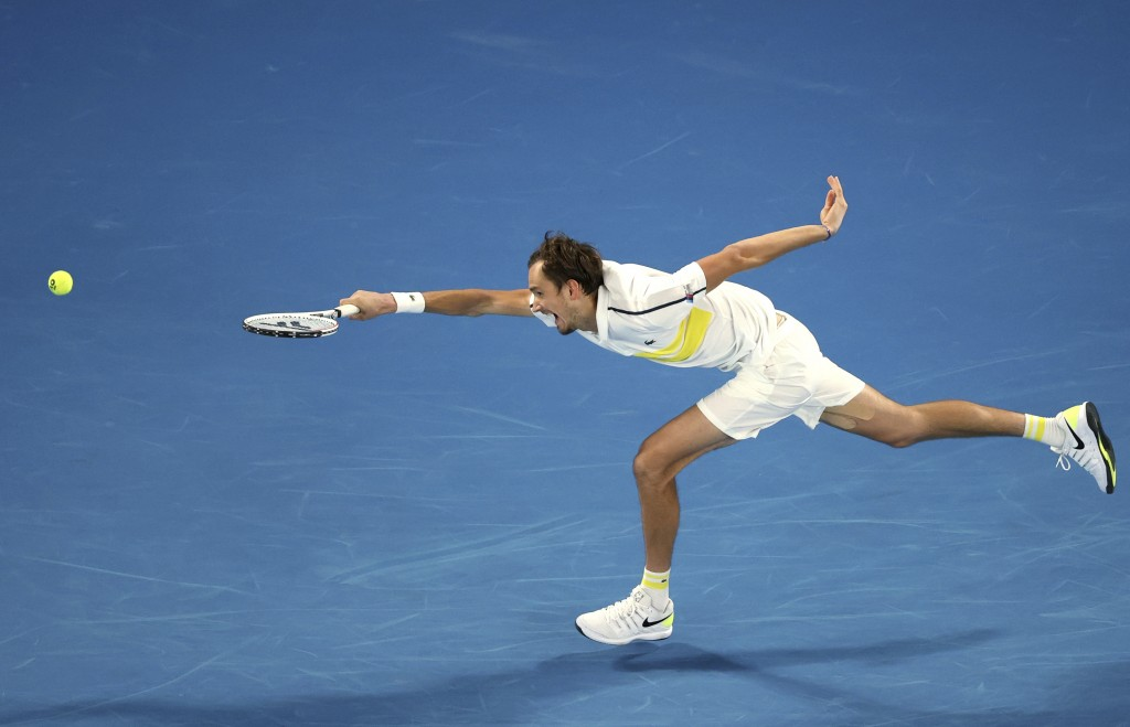 Russia's Daniil Medvedev can not reach the ball to hit a forehand to Serbia's Novak Djokovic during the men's singles final at the Australian Open ten...