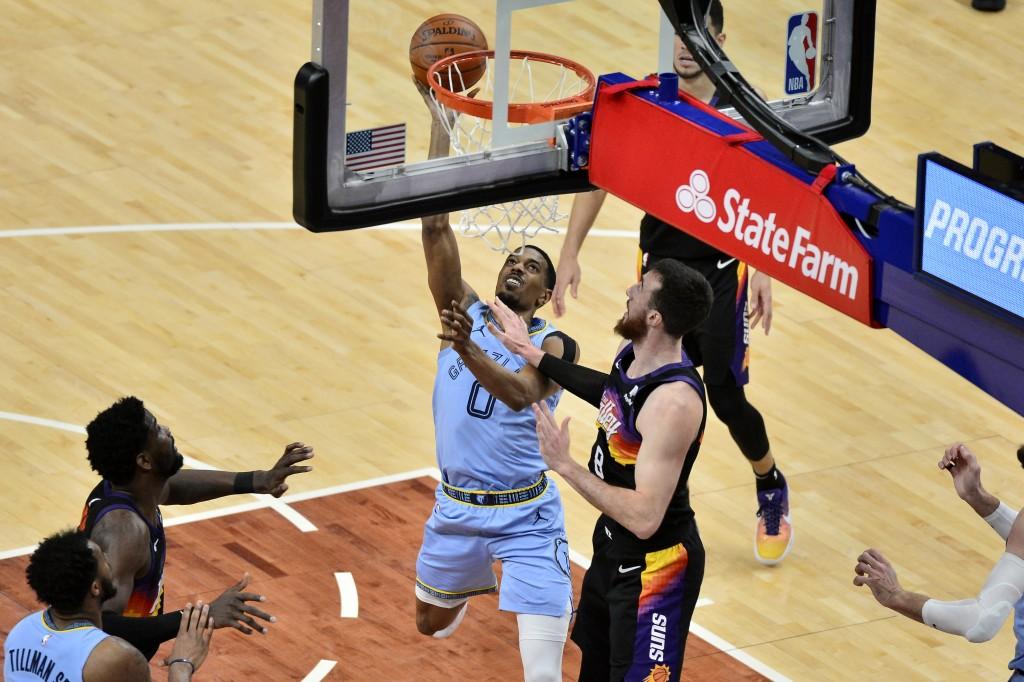Memphis Grizzlies guard De'Anthony Melton (0) shoots against Phoenix Suns forward Frank Kaminsky (8) in the second half of an NBA basketball game Satu...