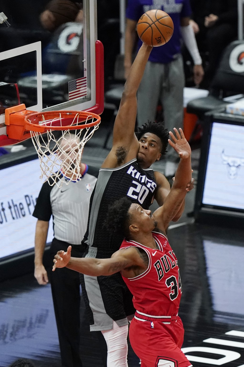 Sacramento Kings center Hassan Whiteside, top, goes up for a dunk against Chicago Bulls center Wendell Carter Jr., during the first half of an NBA bas...