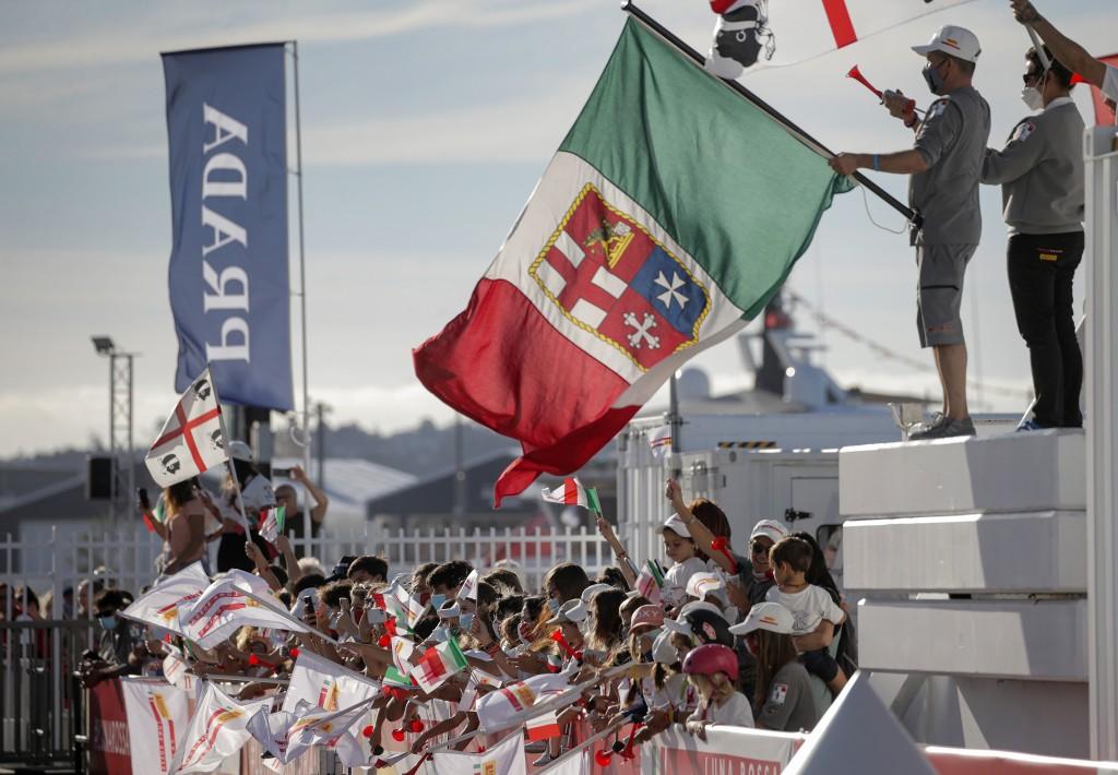 Supporters of Italy's Luna Rossa team join in the celebration after defeating Britain's INEOS Team UK in race eight of the Prada Cup on Auckland's Wai...