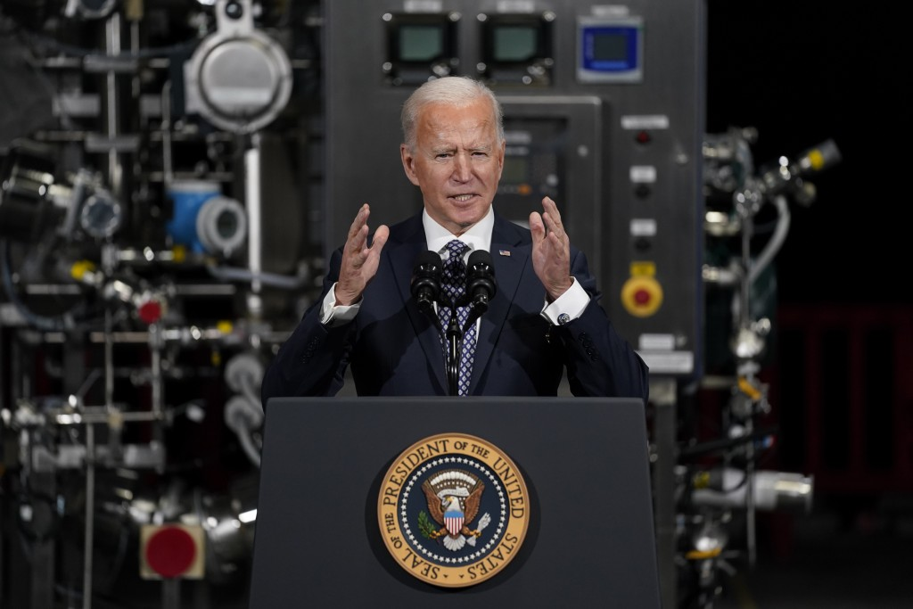 FILE - In this Feb. 19, 2021, file photo President Joe Biden speaks after a tour of a Pfizer manufacturing site in Portage, Mich. (AP Photo/Evan Vucci...