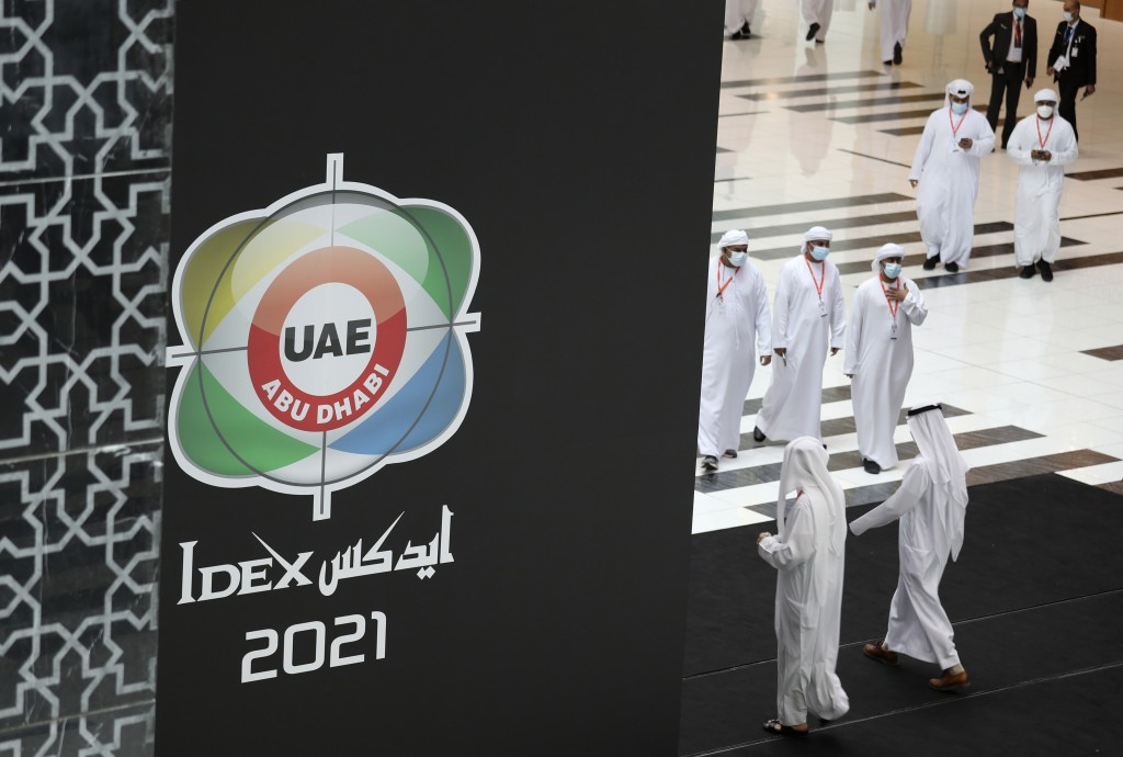 Visitors and officials arrive for the opening day of the International Defence Exhibition & Conference, IDEX, in Abu Dhabi, United Arab Emirates, Sund...