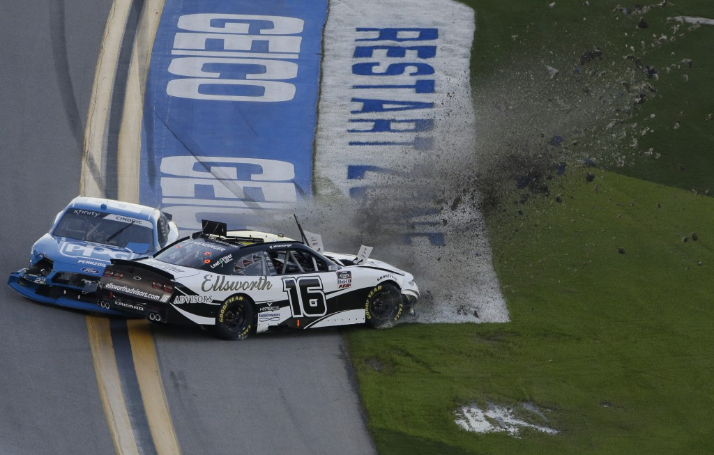 A J Allmendinger (16) and Austin Cindric (22) crash during the NASCAR Xfinity Series road course auto race at Daytona International Speedway, Saturday...