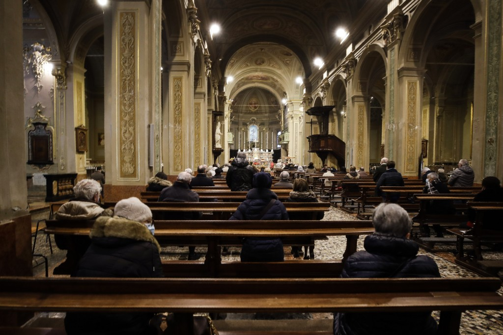 People attend a Mass in Codogno, northern Italy, Sunday, Feb. 21, 2021. The first case of locally spread COVID-19 in Europe was found in the small tow...
