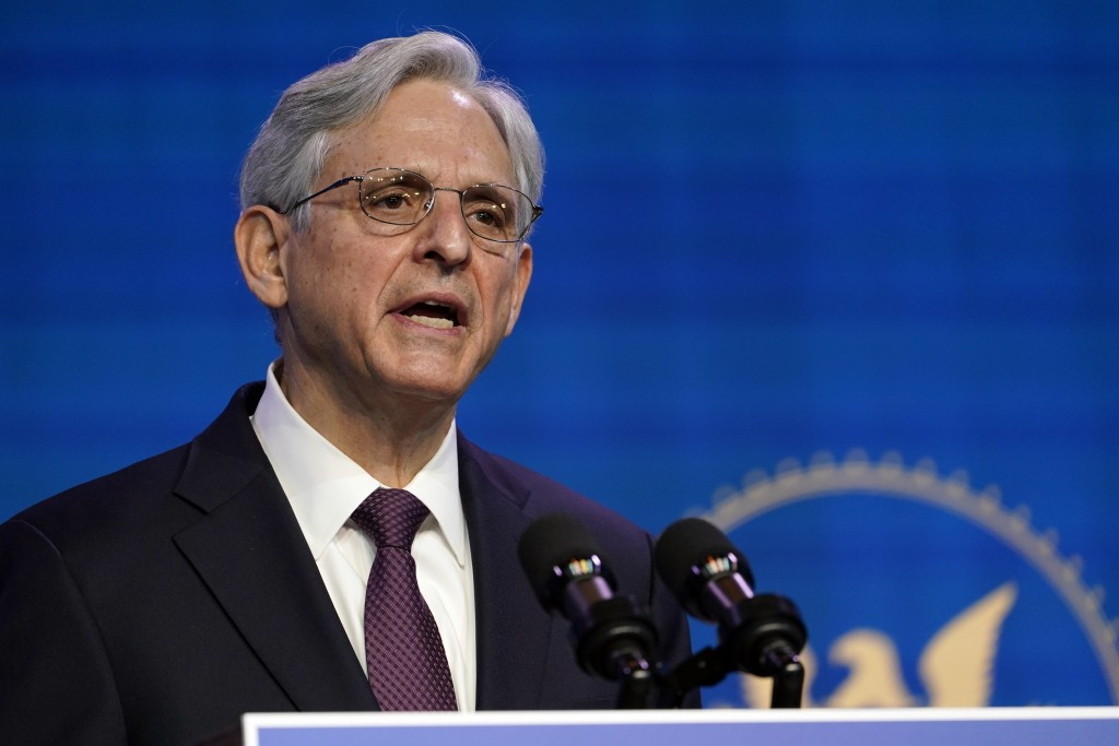 FILE - In this Jan. 7, 2021, file photo Attorney General nominee Judge Merrick Garland speaks during an event with President-elect Joe Biden and Vice ...