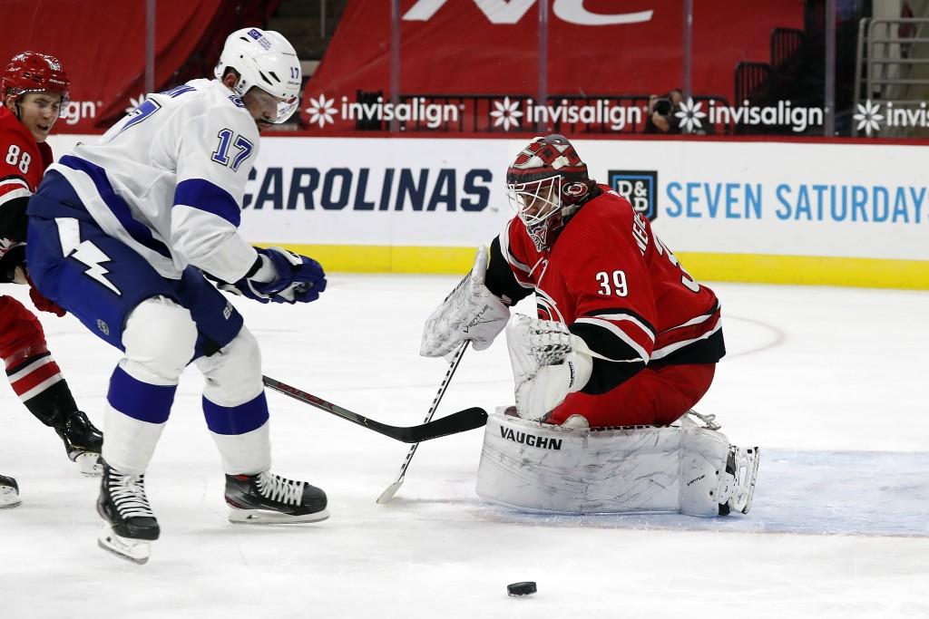 Carolina Hurricanes goaltender Alex Nedeljkovic (39) turns away the shot of Tampa Bay Lightning's Alex Killorn (17) during the first period of an NHL ...