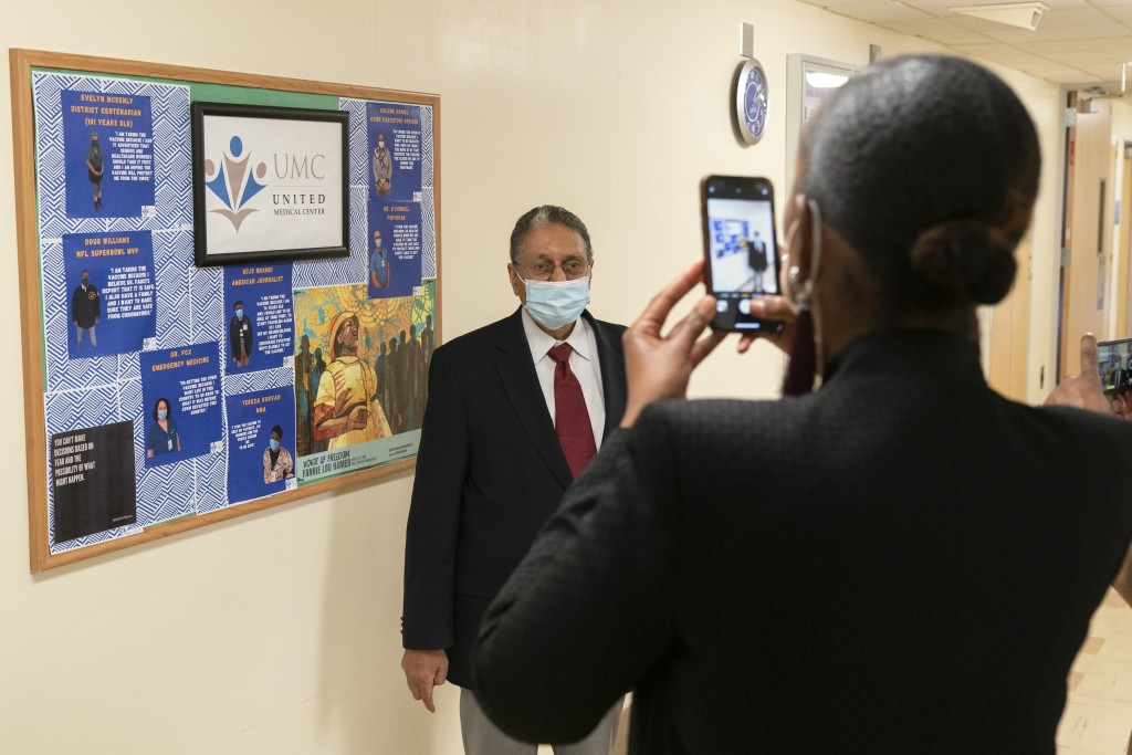 In this Wednesday, Feb. 10, 2021, photo Wallace Charles Smith, 72, who is a pastor at Shiloh Baptist Church, has his picture taken, by United Medical ...
