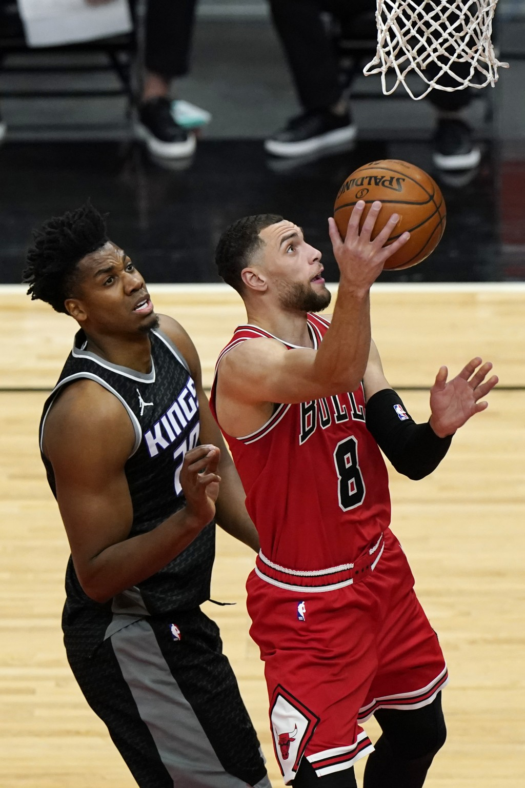 Chicago Bulls guard Zach LaVine, right, drive to the basket past Sacramento Kings center Hassan Whiteside during the first half of an NBA basketball g...