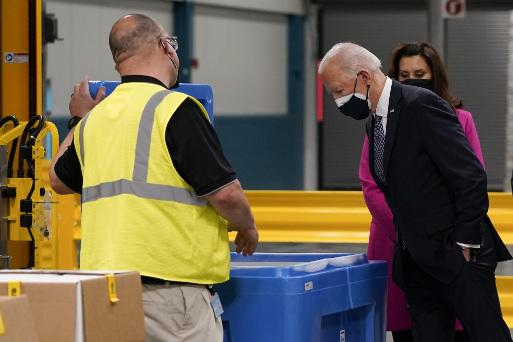 FILE - In this Feb. 19, 2021, file photo President Joe Biden and Michigan Gov. Gretchen Whitmer, tour a Pfizer manufacturing site, Friday, Feb. 19, 20...