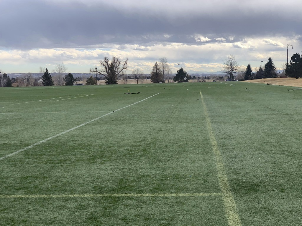 In this photo provided by the Broomfield Police Department on Twitter, debris is scattered across a turf field at Commons Park, Saturday, Feb. 20, 202...