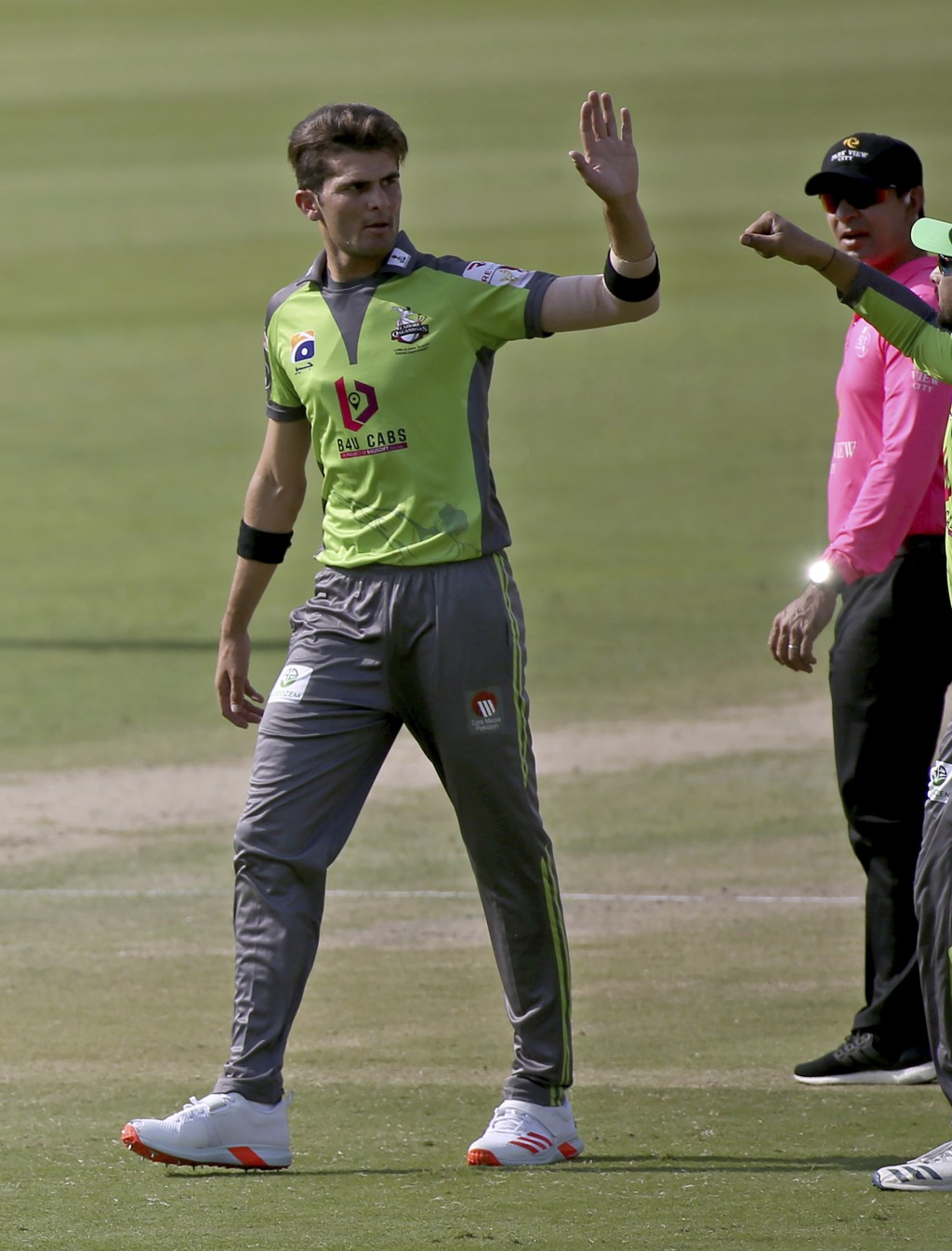 Lahore Qalandars' Shaheen Afridi celebrates after taking the wicket of Peshawar Zalmi's Sherfane Rutherford during a Pakistan Super League T20 cricket...