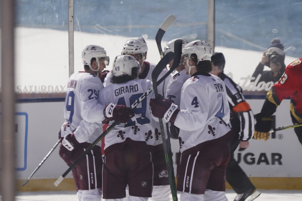 CORRECTS STATE TO NEVADA-Colorado Avalanche defenseman Samuel Girard (49) is surrounded by his teammates after scoring during the first period against...