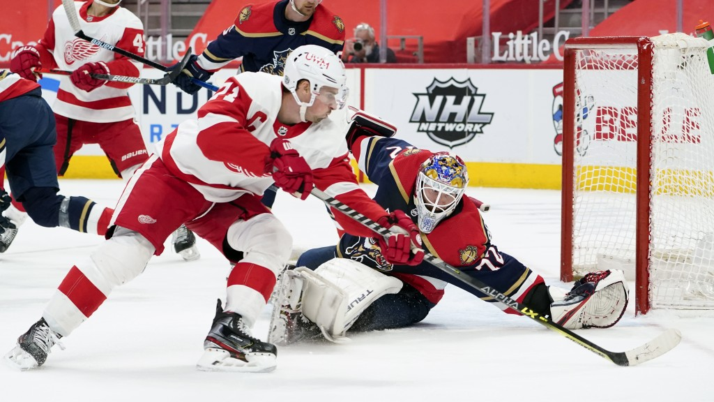 Florida Panthers goaltender Sergei Bobrovsky (72) defends Detroit Red Wings center Dylan Larkin (71) in the second period of an NHL hockey game Saturd...