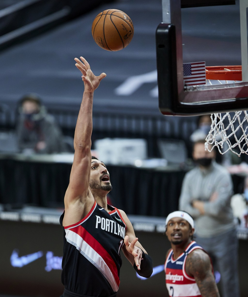 Portland Trail Blazers center Enes Kanter shoots against the Washington Wizards during the second half of an NBA basketball game in Portland, Ore., Sa...
